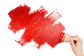 Pintura com pincel vermelho — Fotografia Stock