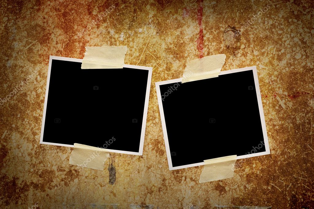 Two blank photos on a grungy wooden background  Stock Photo #1724816
