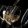 Wine pouring into glasses - Stock Photo
