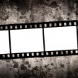 Blank film over grungy background — Stock Photo #1819408