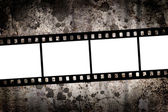 Blank film over grungy background — Stock Photo