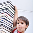 Stock Photo: Big tower of many books vertical and