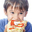Cute little boy eating pizza, isolated — Stock Photo #1769283