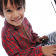 Cute kid sitting with laptop — Stock Photo #1769313