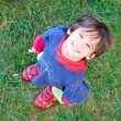 A little cute kid from above on grass — Stock Photo #1769337