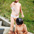 Very cute child playing with water outdo — ストック写真 #1769396