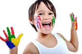 Five year old boy with hands painted i — Foto de Stock