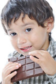 Cute kid eating chocolate — Stock Photo