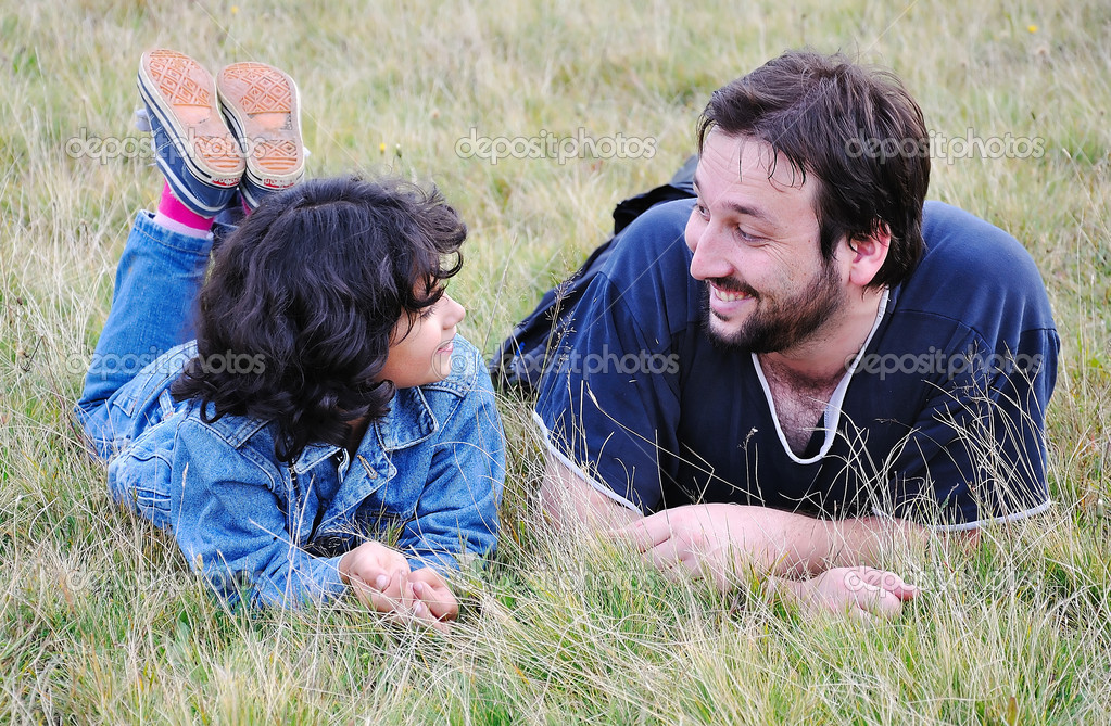 Young father and little cute girl, happiness on meadow — Stock Photo #1769374