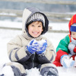Foto Stock: Young beautiful boy outdoor in winter
