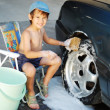 Child washing car and toy car — Stok fotoğraf