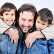 Hugging, father and two sons isolated — Stock Photo