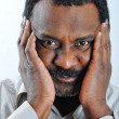 Black man in shirt with expression - Stock Photo