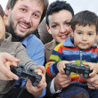 Happy members of young family isolated, playing - Stock Photo