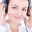 Young beautiful woman with headset liste — Stock Photo