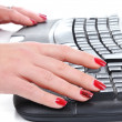 Female hand on keyboard — Stock Photo