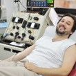 Young man in hospital on bed — Stock Photo