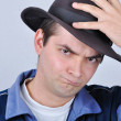 Stock Photo: Young angry man with a hat