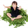 A little cute kid sitting on green leave — Stock Photo #1833376