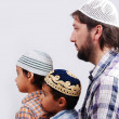 Three members muslim family - Stock Photo