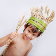 A little cute kid with wheat in hand — Stock Photo