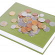 Royalty-Free Stock Photo: Coins on book