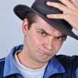 Stock Photo: Young angry man with hat
