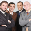 Stock Photo: Group of young businessmen together on light bac