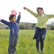 Happy childhood on green beautiful meadow — Stock Photo #1833515