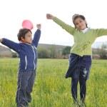 Happy childhood on green beautiful meadow — Stock Photo