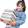 Stock Photo: School girl holding many books