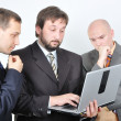 Group of three young businessmen on laptop — Stock Photo