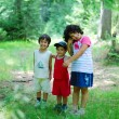 Stock Photo: Children in forest, very greenful scene