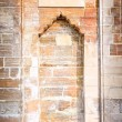 Stock Photo: Shape of gate in rock, brick wall backgr