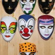 Many different masks on wooden wall — Stock Photo #1833878