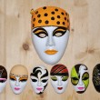 Stock Photo: Many different masks on wooden wall