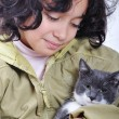 Very cute child with a cat in arms — Stock Photo