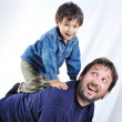 Happy young father with his child on white backg — Stock Photo