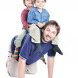 Happy young father with his children on — Stock Photo