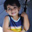 Stock Photo: Very cute child with umbrella, isolated