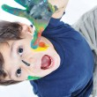 A little cute child with colors on white — Stock Photo #1834145