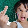 图库照片: Little kid with rude gesture, middle f