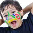 A little cute child with several colors — Stock Photo #1834214