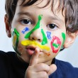 A little cute child with several colors — Stock Photo #1834228