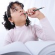 A little cute girl writting on notebook — Stock Photo