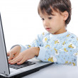A little cute kid with a laptop isolated — Stock Photo #1834268