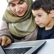 Stock Photo: Little cute kid with laptop isolated