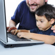Stock Photo: A little cute kid with a laptop isolated