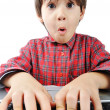 图库照片: Little cute kid with laptop isolated