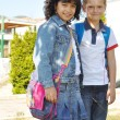 Happy children in front of the school, o — Stock Photo
